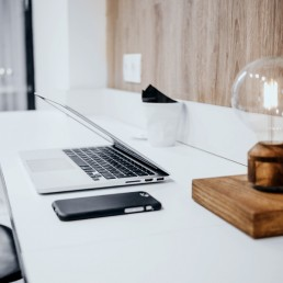 Desktop with laptop, phone and lamp